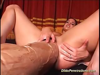 monster dildo deep inside her wet pussy