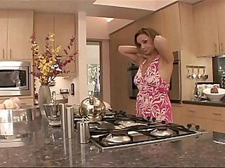 Sophisticated brunette Rebecca Bardoux makes approaches to young hottie Vanessa Leigh on the kitchen